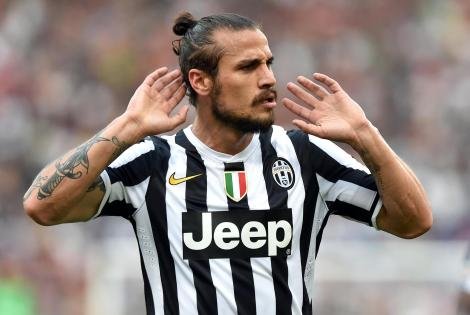 FC Juventus's Pablo Daniel Osvaldo celebrates after scoring the 0-1 during the Serie A soccer match against AS Roma at the Olimpico stadium in Rome, Italy, 11 May 2014. ANSA/ETTORE FERRARI